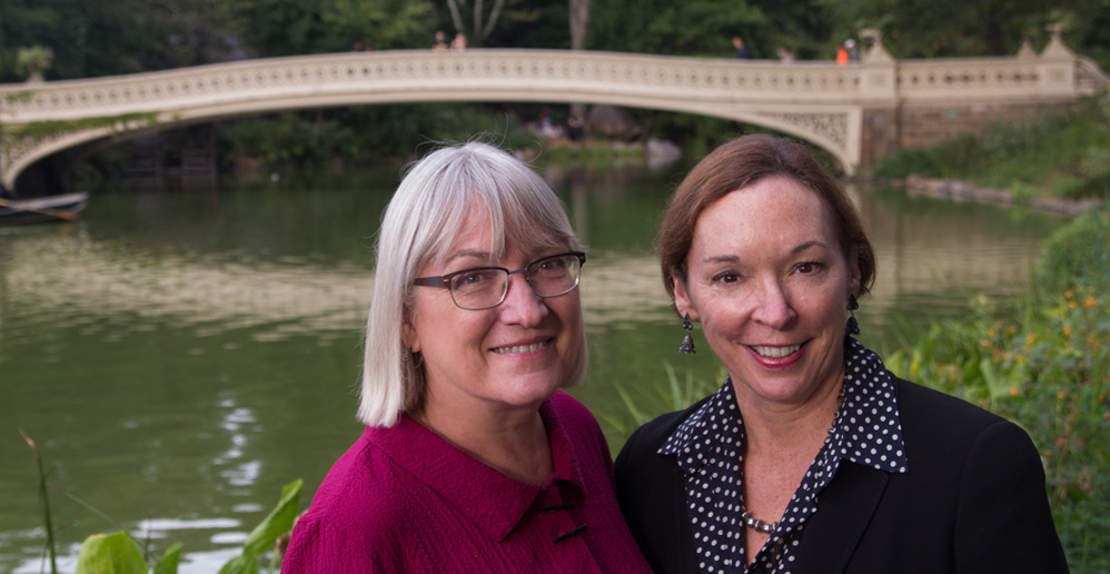 Image of Libby and Heather in front of the Bow Bridge in Central Park
